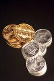 Pièces d'or et en argent Photographie stock libre de droits