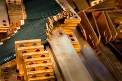 Pièces de cuivre pour l'équipement de production Photographie stock libre de droits