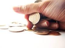 Pièces de monnaie à disposition, argent de poignée Image libre de droits