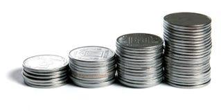 Pièces de monnaie élevant le concept Photo stock