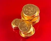 Pièces de monnaie britanniques de chocolat photographie stock
