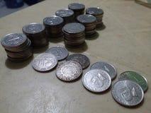 88 pièces de monnaie chanceuses Photos stock