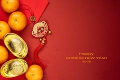 Pièces de monnaie chinoises de la chance ou des lingots de noeud et chinois chinois d'or Photo stock