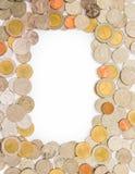 Pièces de monnaie comme le cadre a isolé Photo libre de droits