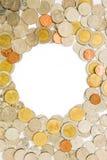 Pièces de monnaie comme le cadre a isolé Photos stock