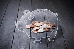 Pièces de monnaie d'argent de tirelire Images stock