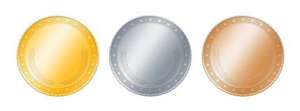 Pièces de monnaie d'or, d'argent, en bronze ou médailles au-dessus de blanc Images libres de droits