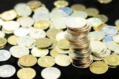 Pièces de monnaie d'argent liquide Photos libres de droits