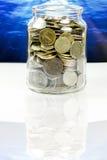 Pièces de monnaie d'argent liquide Photographie stock