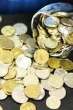 Pièces de monnaie d'argent liquide Photo stock