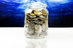 Pièces de monnaie d'argent liquide Photographie stock libre de droits