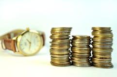 Pièces de monnaie d'argent de temps photos libres de droits