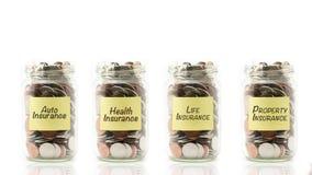 Pièces de monnaie d'isolement dans des pots Images stock