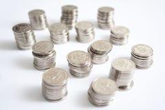 Pièces de monnaie d'isolement sur le blanc Images stock