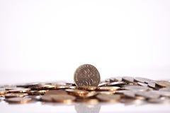 Pièces de monnaie d'isolement sur le fond blanc photos libres de droits