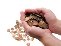 Pièces de monnaie dans des mains Photographie stock libre de droits
