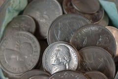Pièces de monnaie dans la fin Images stock