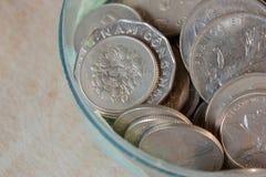Pièces de monnaie dans la fin Photographie stock