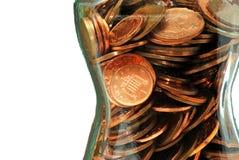 Pièces de monnaie dans le choc en verre Photos stock