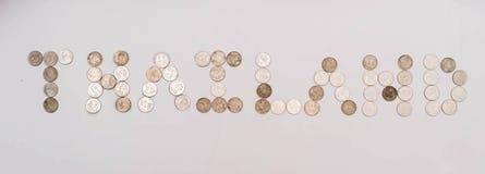 Pièces de monnaie de baht empilées ensemble Image libre de droits