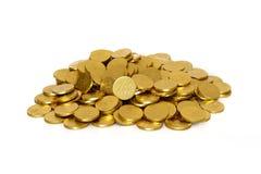 Pièces de monnaie de chocolat sur un fond blanc Photo libre de droits