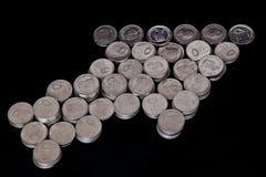 Pièces de monnaie de forme de flèche indicatrice de souris Photo libre de droits