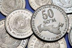 Pièces de monnaie de l'Ouzbékistan Photographie stock