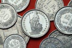 Pièces de monnaie de la Suisse L'Helvétie debout Photo stock