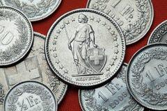 Pièces de monnaie de la Suisse L'Helvétie debout Photos stock