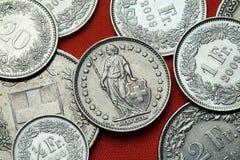 Pièces de monnaie de la Suisse L'Helvétie debout Photos libres de droits