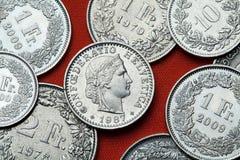 Pièces de monnaie de la Suisse Tête de Libertas Image stock