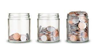 Pièces de monnaie des pots Photos stock