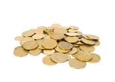 Pièces de monnaie dispersées. Image stock