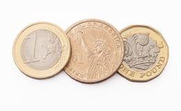 Pièces de monnaie du dollar, d'euro et de livre Images libres de droits