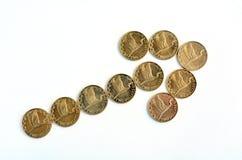 Pièces de monnaie du dollar de NZ avec la flèche de tendance à la hausse Photo libre de droits