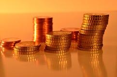 Pièces de monnaie empilées Photos stock