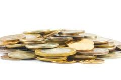 Pièces de monnaie en métal d'isolement sur le blanc Image libre de droits