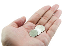 Pièces de monnaie en main Images stock