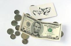 Pièces de monnaie et cinq dollars Photos libres de droits