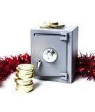 Pièces de monnaie et décoration sûres et d'or de Noël photographie stock libre de droits
