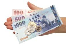 Pièces de monnaie et factures normales de Taiwanse Photo stock