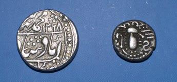 Pièces de monnaie indiennes antiques Photos stock