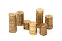 Pièces de monnaie jalonnées Images stock