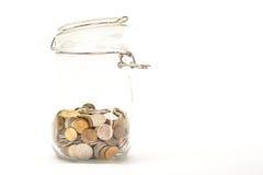 Pièces de monnaie russes dans un pot en verre Image libre de droits