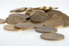 Pièces de monnaie sur le blanc Images libres de droits