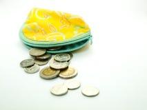 Pièces de monnaie thaïes chez la bourse de la femme Photographie stock