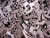 Pièces en acier perforées crues Photographie stock