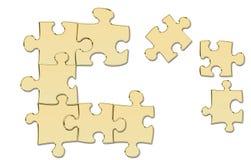 Pièces en or de puzzle images stock