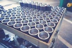Pièces en métal après usinage sur une machine de métal-coupe Image libre de droits