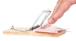 Piège de souris avec l'argent Image stock